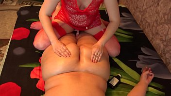 A sexy masseuse in early pregnancy massages a fat lesbian and with a big ass.