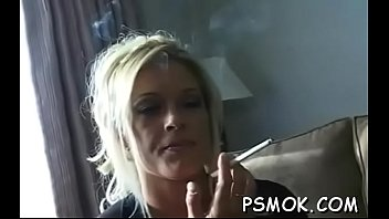 Elegant chick in sexy lingerie likes to tease during the time that smokin' thumbnail