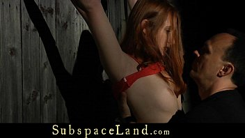 Rebellious redhead masturbated in a harsh bdsm submission