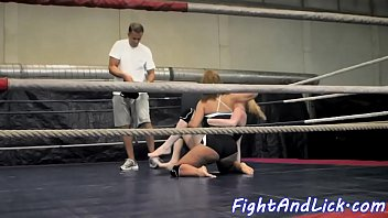 Athletic lesbos wrestling in the boxing ring