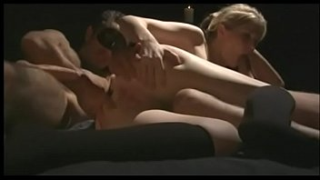 Sexy blonde slut sucks blindfolded guy's cock a front of candles while his friend with big dick drills her tight asshole from the behind