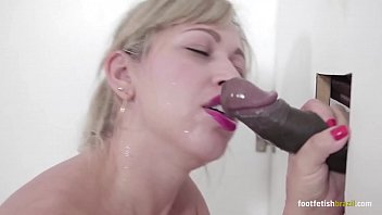 Foot kissing lit erotica Mirella mansur at gloryhole playing with a big black dick and doing footjob, sucking all and taking a huge cumshot in her mouth