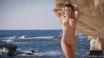 Sexy blonde model strips naked outdoor and teases us