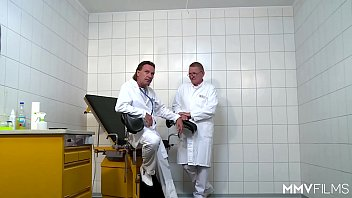 Doctors Treating A Patient's Butthole