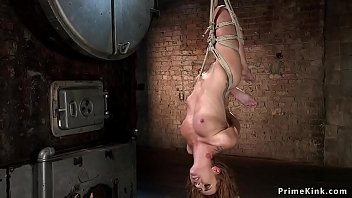 Curly redhead slave caned in hogtie