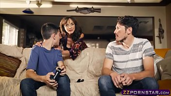 Awesome MILF helps out a gamer guy who has a huge erection