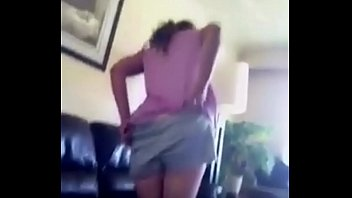 A mother mooning at her daughter holding a camera
