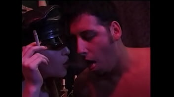 Experienced whores in black lingerie smoke cigarettes and extinguish them on the intimate parts of a young guy