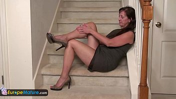 Classy mature lady solo play on staircase