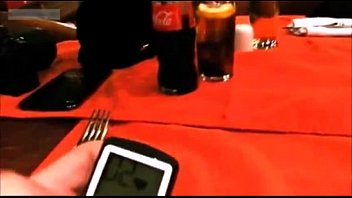 Girl in restaurant playing with remote vibrator