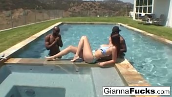 An interracial poolside threeway with big boobed Gianna