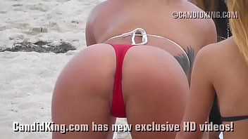 Women asses thongs - Sexy teen on the beach showing tan thong covered ass in public