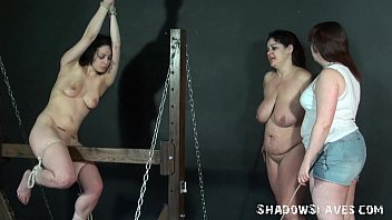 The sexual wooden pony Wooden horse bondage and palm spanking of two caned lesbian slave girls in extre