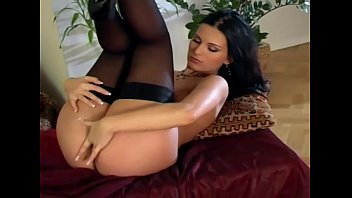 Beautiful brunette masturbates in black nylon