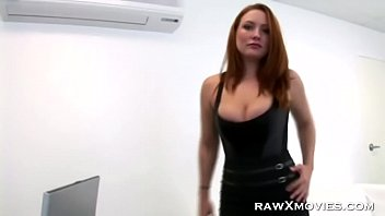 Busty redhead banged in the office