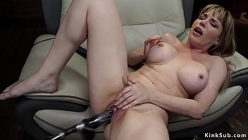 Blonde Milf fucks machine in armchair