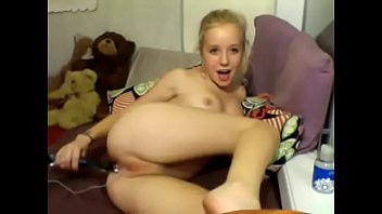 blonde is playing with her pussy on cam