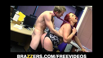 Busty redhead secretary is slammed by the biggest dick she's had