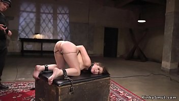 Clamped brunette slave threesome bondage