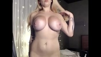 Hot woman gets naked showing big boobs Vorschaubild