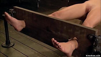 Blonde in back bend bondage is whipped