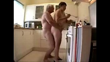 Old grand parents having fun in the kitchen. Amateur