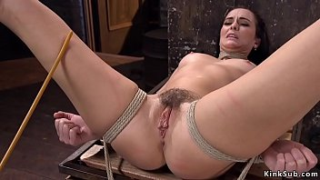 Hogtied babe gets hairy pussy caned