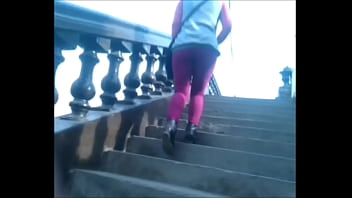 ASS IN PURPLE LICRA CLIMBING THE STAIRS