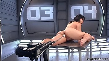 Asian shovs fucking machine up her ass