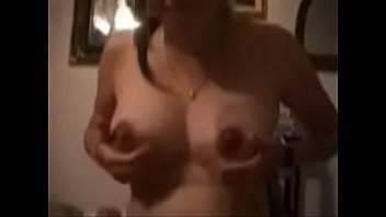 milking her tits while she milk s his cock