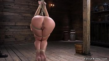 Huge tits babe is flogged in suspension