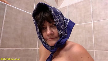 ugly 73 years old granny peeing at the bathtub