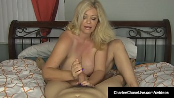 Want your cock serviced by a horny milf in your bed? The Beautiful Charlee Chase shows off her huge tits as she wraps her expert hands around your hard shaft to make you cum for her!