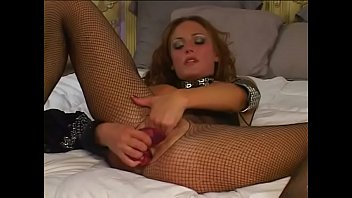 Juicy Venus with curly red hair in black outfit uses long pink dildo to feel double penetration