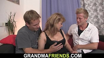 Two dudes pick up busty mature woman