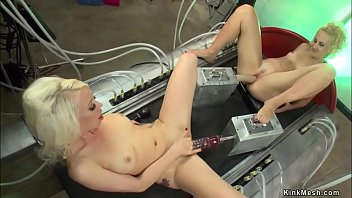 Blonde lesbians fuck machines together