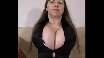 Busty busting her shirt buttons with her breasts