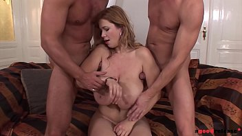 Bust brunette fucked by two cocks