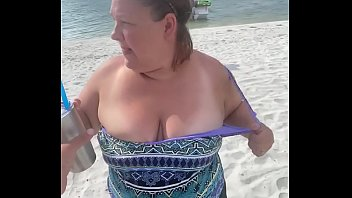 Slutty Bbw duca wife flashes her big tits on a public beach