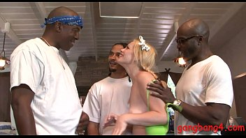 Sexy blonde babe banged by black guys in many positions