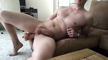 Hunk plays with thick uncut cock and fucks ass with big dildo