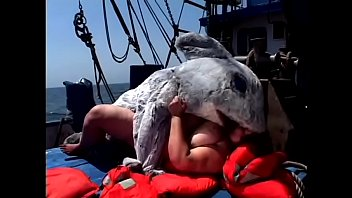 Huge bitch Tia Davis gets fucked and creamed by a man in a dolphin costume on the ship