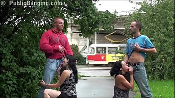 A pregnant girl in a public street foursome