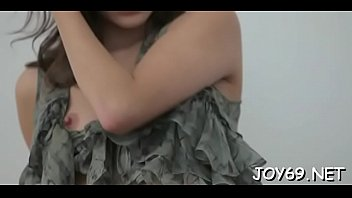 Pleasing teen babe satisfies herself in a softcore act