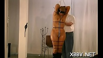 Non-professional sucks dildos with her marangos tied up in ropes