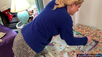 Stepmom is focused on her puzzle but her tits are showing and her stepson fucks her