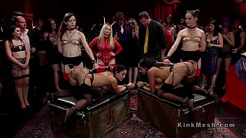 Group of hot slaves serving at kink ball