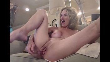 Silicone GILF Rubs Mature Pussy On Cam