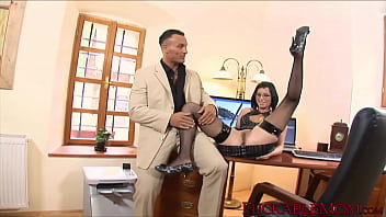 Dashing MILF with glasses bent over her desk and hammered
