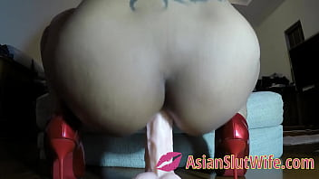 ASIAN SLUT TAKING A 12 INCH DILDO IN THE ASS